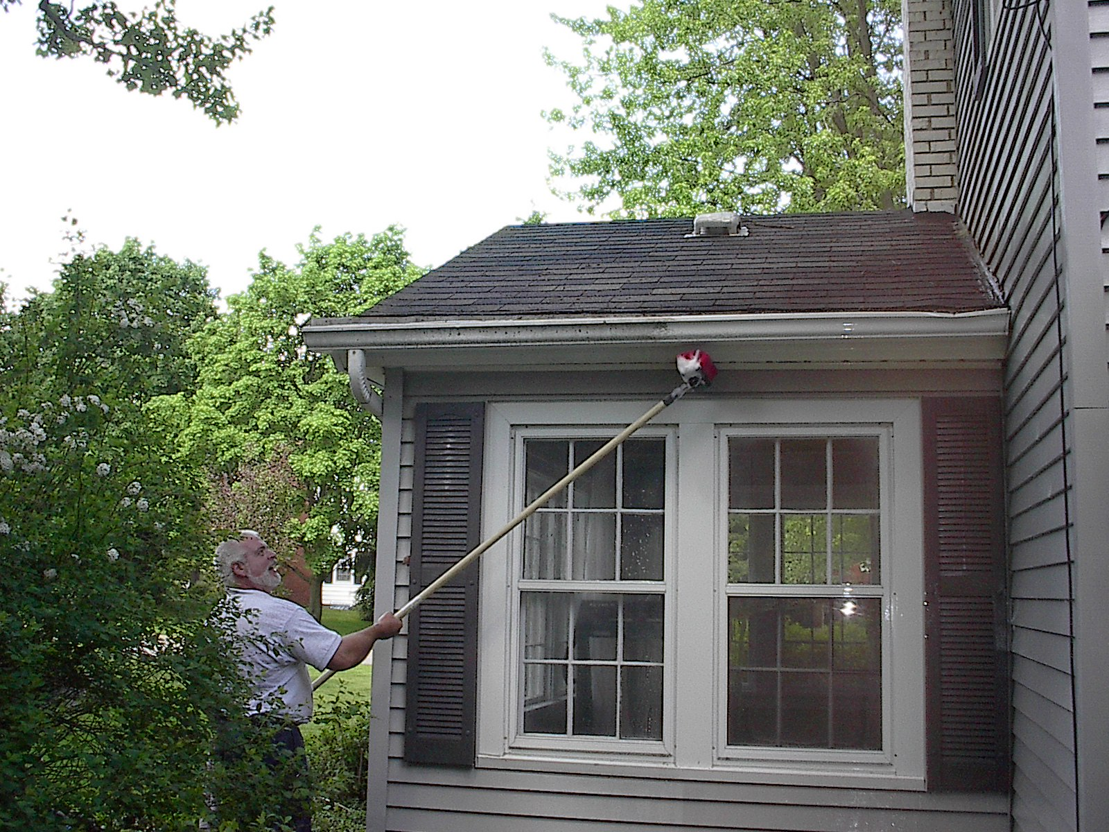 """While we all know why a clean home is important, we might not know how to keep it clean. If you want to sell, is your home making the most of its """"first impression"""" potential? Home Team Power Clean is western Michigan's resource for a house washing service that puts your property on the map and helps it stand out above the other homes in your neighborhood. A New Level Of Clean A beautiful property can get hidden behind a layer of dirt and grime. Our house washing service is a great option for any exterior – vinyl, composite, wood, stone, and stucco – Home Team provides the appearance that most homeowners yearn for. Home Team delivers successful results thanks to our complete commitment to quality. All of the technology, cleaners, and equipment at your property will be cutting edge. And they'll be deployed by a team who knows how to safely restore your exterior for 20 years and running. Behind Our Process We care about the long-term value of your home exterior. That's why, instead of a conventional pressure washing service, we have a soft washing system designed to combat dirt without the forceful impact. Cutting Edge Technology: Our state-of-the-art mobile system dispels water at high and low pressure with finesse to: Remove dirt, dust, and grit Kill and remove algae, mold, and mildew Eliminate stains, streaks and cobwebs With water softening technology, plant-friendly detergents that actually clean your home, the sky's the limit when it comes to our cleaning capabilities. Our goal is to create a beautiful home for every customer. With our house washing service, that first impression is yours for the taking. Most Home Team clients will tell us: """"My home has never looked this good before!"""""""
