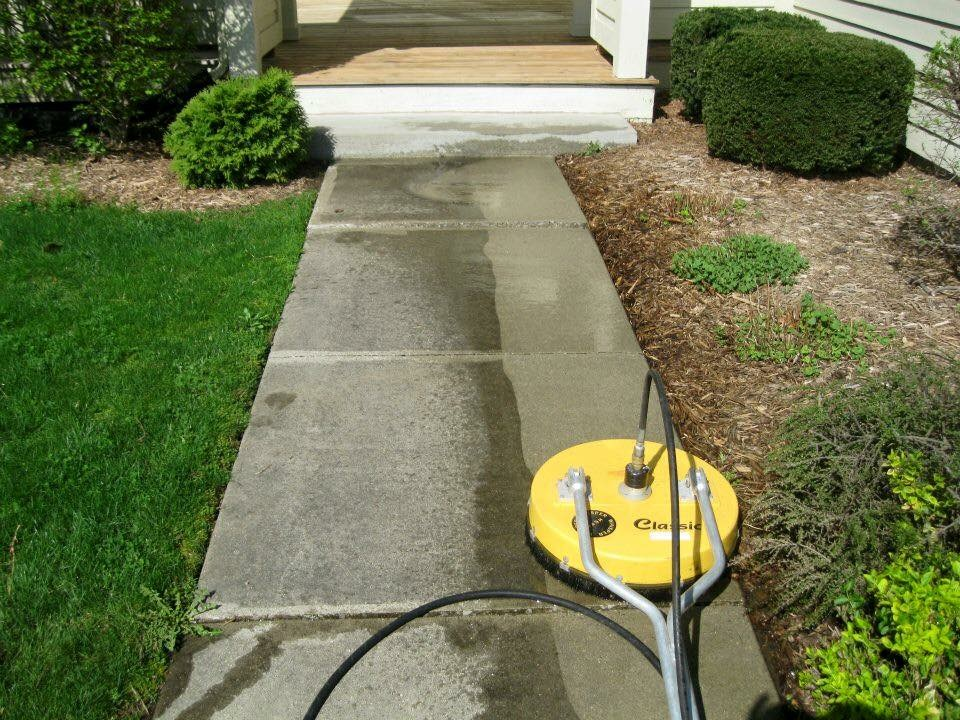 """When curb appeal is the goal, start from the ground! Home Team Power Clean is Michigan's supplier of driveway and sidewalk cleaning services that keep your property on point. A Cure For Dirty Concrete Next time you walk around your property, take a look around: What do you see? Many high traffic areas fall victim to wear and tear faster than your average surface. Some of the most common issues include sludge from vehicles, chewing gum, and general stains. The best way to cure dirty surfaces is a professional pressure washing service. This solution will protect the appearance of your driveway or sidewalk – but it will also set it up for a longer lifetime and better quality. Pressure Washing For Curb Appeal Our technicians will arrive at your property with a whole suite of technology designed to restore your surfaces. We use a cutting edge pressure washing system that utilizes softened water, top-quality cleaners, and high volume pressure to restore the surfaces that need it most. We: Remove chewing gum and other buildup Eliminate stains from grease, oil, and other sludge Remove streaks and fading With the work of our technicians, your driveway and sidewalk will project better, safer and bright curb appeal for your entire property. The results pay off: Clients can expect a better first impression. """"Keep it Clean Battle Creek!"""""""